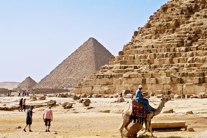 Maximize your time in Egypt by traveling to the Giza Pyramids and Egyptian Museum by air from Hurghada. Following a short flight to Cairo, you'll head straight to the Giza Pyramids to uncover the mysteries of ancient Egypt. Gaze upon the iconic Sphinx statue; behold glittering treasures in the Egyptian Museum; and explore the ancient streets of Old Cairo. Round-trip flights, hotel transfers, and lunch are included on this private tour.<br><br>
