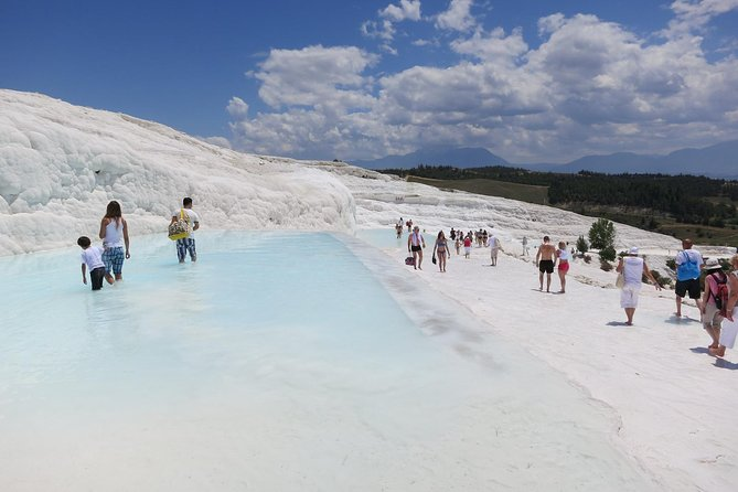 Visit Pamukkale hot springs that contain travertines, see the terraces of carbonate minerals left by the flowing water. Then visit the ancient city of Hierapolis.