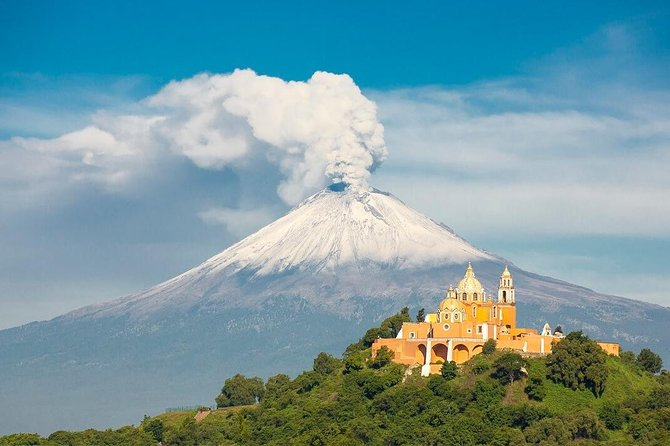 "This tour offers a visit to two of the most emblematic cities of this region: Puebla and Cholula and the smallest volcano in the world Cuexcomate.<br><br>According to the legend, a bishop was told by angels the specific location of the future city of Puebla. By the ""City of Angels"" there is a picturesque road, guarded by two active volcanoes Popocatepetl and Iztaccihuatl, snow-capped peaks that rush into the sky. The city itself will amaze you splendid colonial architecture, historical monuments, among them Rosario Chapel, Convent of Santo Domingo, the city's cathedral, protected by UNESCO.<br><br>Enjoy these wonderful places accompanied by a professional photographer who'll capture all your special moments during excursion.  <br><br>Full day excursion."