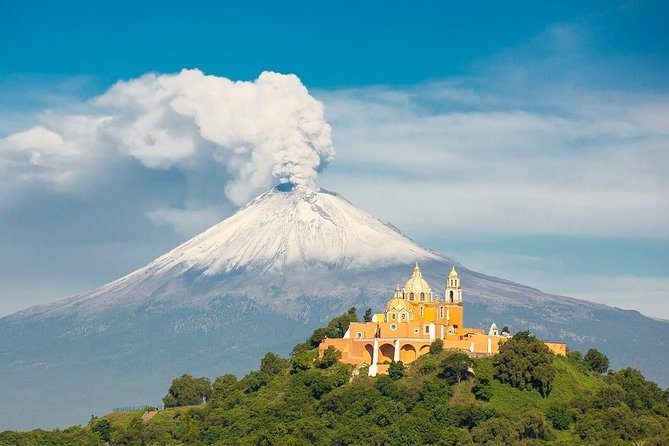 "This tour offers a visit to two of the most emblematic cities of this region: Puebla and Cholula and the smallest volcano in the world Cuexcomate.<br><br>According to the legend, a bishop was told by angels the specific location of the future city of Puebla. By the ""City of Angels"" there is a picturesque road, guarded by two active volcanoes Popocatepetl and Iztaccihuatl, snow-capped peaks that rush into the sky. The city itself will amaze you splendid colonial architecture, historical monuments, among them Rosario Chapel, Convent of Santo Domingo, the city's cathedral, protected by UNESCO.<br><br>Puebla City, also called ""Puebla City of Angels"", is the second most important Spanish colonial city, located southeast of Mexico City and west of Golf of Mexico's main port, Veracruz, right at Central Mexico."