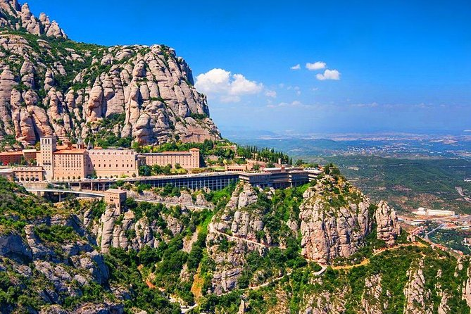Ensured small group tour of maximum 8 pax.<br><br>Round-trip hotel pick-up & drop-off included.<br><br>Make a pilgrimage to the mystical mountaintop retreat of Montserrat in this 5-hour excursion from Barcelona with a very small group. Make the best of such a small group and decide how you want to spend your time.<br><br>Your guide will invite you on an exploration of this nearly 1,000-year old Benedictine Monastery set high above Catalonia. You'll see the famous 'Black Madonna' 12th century icon. End the tour by enjoying the sublime singing of 'La Escolania de Montserrat' one of the Europe's oldest children's choirs.<br>- Half-day trip to the mystical mountaintop monastery of Montserrat with a small group from Barcelona<br>- Admire the famous 'Black Madonna', icon in the monastery basilica<br>- Explore the 'Holy Cave' where the Virgin is said to have once appeared<br>- Enjoy astonishing views of the natural park<br>- Great way to explore the region near Barcelona