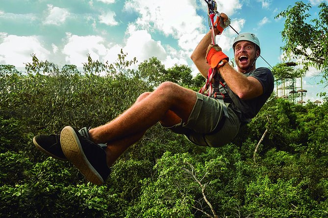 Gear up and before you know it you'll be high up over a tree overlooking the jungle. Your heart will be pounding and the adrenaline flowing as you take flight on the first of 10 Worldclass Ziplines, (the last zipline is for you to decide if you want to finish dry or get soaked in our all new AquaZip!), then, you're off to Tarzania, the Zipline Coaster. This is the ultimate jungle ride to unleash your primal Tarzan yell!!<br><br>Once your feet are back on the ground it's time to head farther into the jungle on a Safari Truck ride; your destination…our very own private cenote. This natural water hole is the perfect way to freshen up and play!!