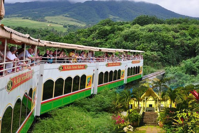 This unique, customised, and family friendly tour is the only one being offered in St. Kitts that takes in the Wingfield Estate and rustic St Kitts by train. Our tour is approximately three hours duration in air conditioned comfort. The first leg of our tour will be by bus from downtown Basseterre to Wingfield Estate. You have the opportunity to stop the bus at any time along the way for photo taking. Your knowledgeable on board tour guide will provide expert commentary on historic Basseterre, Capital of St. Kitts and its environs. Our stop at Wingfield Estate is about 30 minutes, where you will be able to walk through the ruins of the old Estate and see what the archaeologists have unearthed . Your journey then continues by bus to the La Vallée Train Depot for a ninety minute scenic railway ride along a line that once transported sugar cane down the coastline of St. Kitts. Enjoy the quaint and picturesque beauty of St. Kitts. Then it's back to the point of departure, Basseterre.