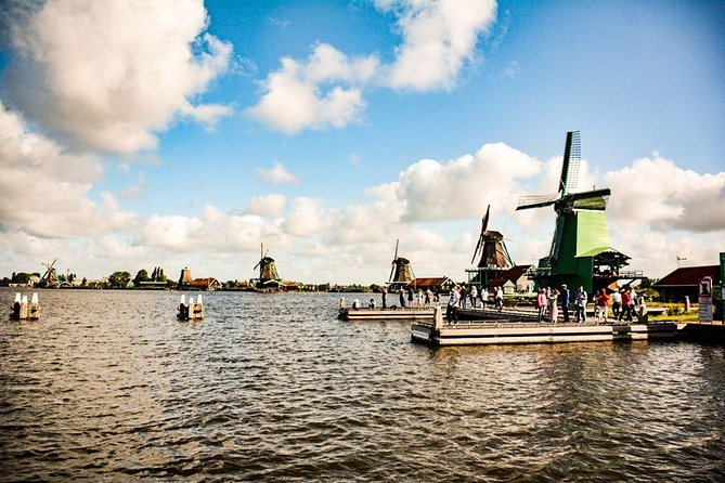 """Board a comfortable mini van and you'll be taken to the famousZaanse Schans where you will see the original still working Dutch windmills. If you fancy you can visit some of the well known museums. A nice asset to this trip will be your encounter with millers when you are strolling down the Zaanse Schans. You can glance over their shoulder while they are performing their crafts. You""""ll learn how the typical wooden clogs are made and why the Dutch traditionally wore them. You will also see how cheese is made."""