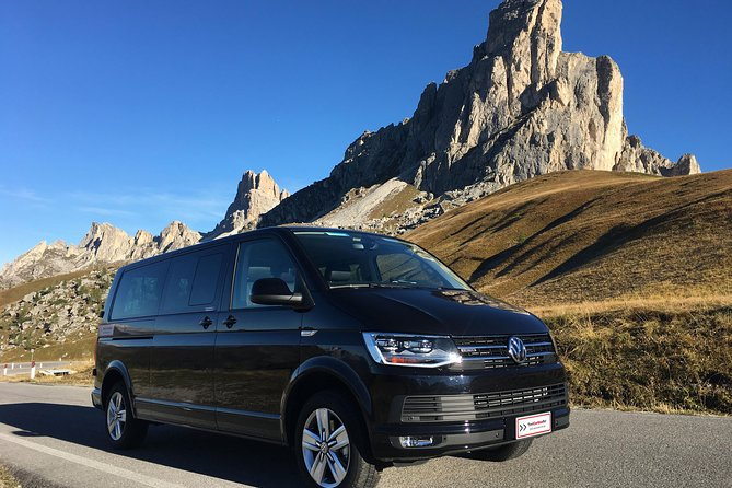 Enjoy a sightseeing tour to reach the heart of the Dolomites starting and ending in Cortina d'Ampezzo. <br>A professional local English speaking driver will meet you at the hotel and drive you on part of the Old road of the Dolomites around the Sella mountain, giving you the possibility to admire spectacular mountains as Tofana, Cristallo, Sorapiss, Antelao, Pomagagnon, Croda da Lago, 5 Torri, Lagazuoi, Sella, Marmolada, Sassolungo, Sassopiatto, Avearau and Nuvolau.<br>You will be able to stop for pictures with explanations about the mountains, history and traditions and will receive a map of the itinerary.<br>You can join 2 cable cars* for mountain sightseeing and have a typical lunch* facing the Dolomites. <br>Bottles of water and Wi-Fi free on board.<br>Minimum of passengers required is 4, we will keep you updated if others join. If your group is made by at least 4, you can ask for a private tour.<br>*=extra cost