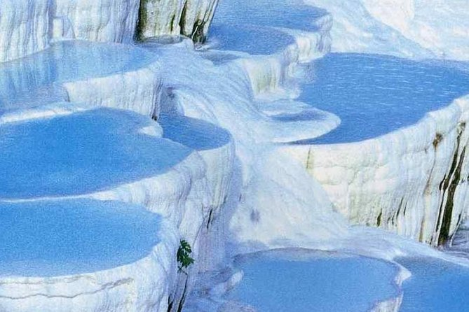 Visit Pamukkale and walk along the Hierapolis ancient city ruins, see the huge Necropolis, and feel the warmth of the natural spring as you go barefoot on the Tavertine pools.