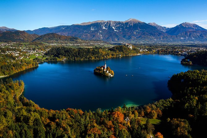 Discover three of Slovenia's top attractions in one day on this scenic small-group day trip from Ljubljana. Marvel at beautiful Lake Bled and ride a traditional 'pletna' boat to Bled Island to explore and perhaps try scrumptious 'potica' nut cake. Then, explore Bled Castle perched above the lake before free time for lunch. Finally, visit cliffside Predjama Castle and ride a mini-train into Postojna Cave, the famous cave network of stalactites, stalagmites and eerie halls. <br><br>Visit the main tourist sights in one day and enjoy a magnificent day exploring some of the best Slovenian attractions. On our tour we treat you with a traditional pletna boat ride to Bled island and visit the only Slovenian island. On the island you can enter the Church of the Assumption and even ring the wishing bell, which has been ringing over Lake Bled since 1534. After the pletna boat ride you will explore a thousand years old Bled castle, which is also one of the most spectacular castles in Slovenia. You visit also the castle museum, which gives you an insight into the history of the entire area. Take few minutes to admire the amazing views of Lake Bled from several viewpoints at the castle. In the afternoon it is time to explore some underground attractions. You will visit Postojna Cave, the best-known cave in the world and one of the largest Karst monuments. Start the adventure with a unique ride with a special train that will take you to discover galleries and magnificent halls full of interesting stalactites, stalagmites and the most famous cave animal human fish (proteus anguinus). A scenic road will take us to idyllic village of Predjama where we will explore one of the most interesting castles in Slovenia, The Predjama Castle. It is perched high up in a vertical cliff and it has been placed on lists of top 10 castles to see in the world. Erazem of Predjama (Erasmus) is the main protagonist of numerous legends – on the one hand these legends glorify him as a passionate, handsome and noble knight, while on the other he is described as a bandit and a robber baron who met his death on the toilet.  <br>