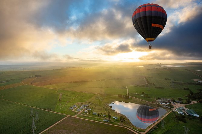 Experience an amazing Hot Air Balloon Flight in Africa's most spectacular winery region, with outstanding vineyards and mountains in the Cape Winelands, a leisurely 30 minute drive from Cape Town's CBD. It is a natural amphitheater, which makes it the perfect location for a ballooning tour: great views, native fauna and flora, excellent food and wine and stable weather. Let the breeze usher you along the corridors of grape vines and green pastures as you lose yourself in the breathtaking views of mountains that surround the valley. This region has excellent locally grown food/wine and makes for a brilliant experience in the Cape Town countryside