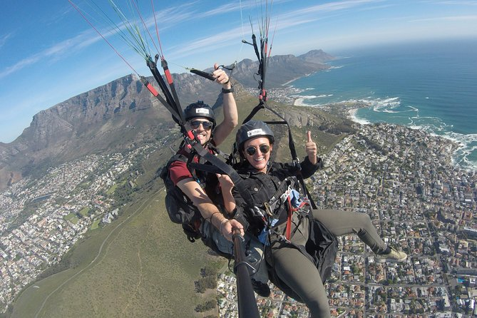 Hi5 Tandem Paragliding is a company who love to share the ease, exhilaration and absolute freedom of tandem paragliding flights. Tandem paragliding flights are done from Lions Head and Signal Hill within the spectacular Table Mountain National Park. With a well organised and professional service you can relax and enjoy the ultimate tandem paragliding experience with Hi5 Tandem Paragliding.<br><br>Seapoint promenade opposite the Winchester Mansion and the fields at the Glen Country Club/Bungalow Restaurant are the two preferred paragliding landing fields. Tandem paragliding flights vary in length as they are very dependent on weather conditions and can vary from about 8 to 20 minutes.<br><br>Hi 5 Paragliding pilots pride themselves on the quality and duration of the paragliding flights, so they will paraglide with you for as long as possible because they love to fly!<br><br>We will also return you to your vehicle on the mountain after the flight free of charge.