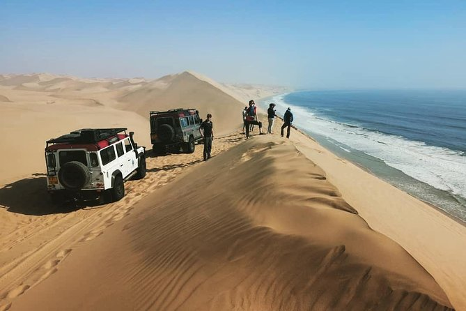 """The Marine Dolphin Cruise followed by a 4×4 dune excursion to Sandwich Harbour in the NamibNaukluft Park - the Epic combination of the bestoff both worlds. <br><br>After the splendours of the <br><br>Mola Mola Marine Dolphin Cruise you disembark onto the Waterfront Jetty and board the 4×4 vehicles. This is when the sandwich Harbour Dune Experience begins. Mola Mola has coineda phrase for the Marine Dune Day – <br><br>""""EPIC IN A DAY"""" – this sums up the cruise in the Walvis Bay Lagoon area with seals and dolphins, and then the adventure and beauty of big dune driving and breath taking scenery, all in one day! A light lunch, with oysters, is served on the boat and afternoon snacks are served on thethe dunes."""