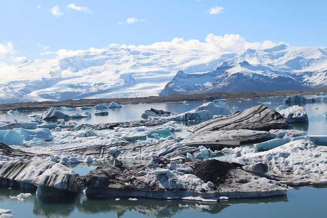 Be amazed by the frozen enchantment of Europe's largest glacier lagoon on a full-day tour of the legendary Jökulsárlón Glacier Lagoon from Hofn. Marvel at a landscape comprising of crystal clear water and floating icebergs as you explore the area. Add some sparkles to your day at the Diamond Black Sand Beach. Explore some secret glaciers in the Vatnajökull National Park where the largest glacier in Europe lies.  <br> • Jökulsárlón Glacier Lagoon, Diamond Beach and Secret Glacier <br> • Private tour <br> • Highly rated and recommended by guests