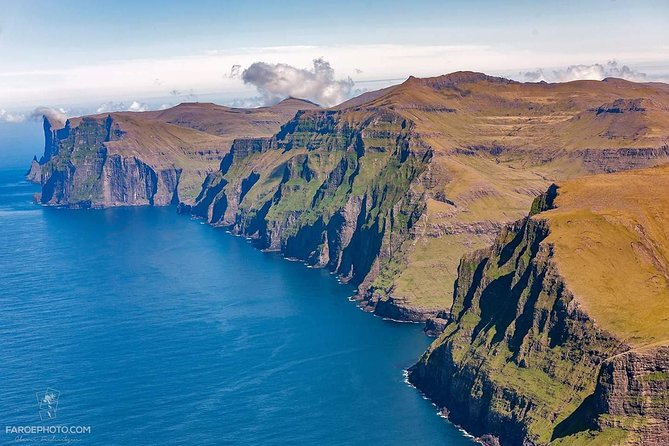 Enjoy the Vestmanna sea cliffs and northern Streymoy on this 7 hour day tour. The tour starts in the capital Tórshavn and you will drive in a comfortable vehicle in fantastic surroundings on the mountain road towards Vestmanna, were you will get the view at the island Koltur and see the only prison of the Faroe islands. <br><br>while driving, the tour guide will tell you about faroese history, folklores and daily life on the Faroe Islands. <br><br>after the sail trip, you will be greeted with a packed lunch and drinks before heading to Kvívík, were some of the best kept viking settlements in the Faroe Islands are located. <br><br>after visiting Kvívík it's time to head back home to Tórshavn, and you will be dropped of right at your hotel.