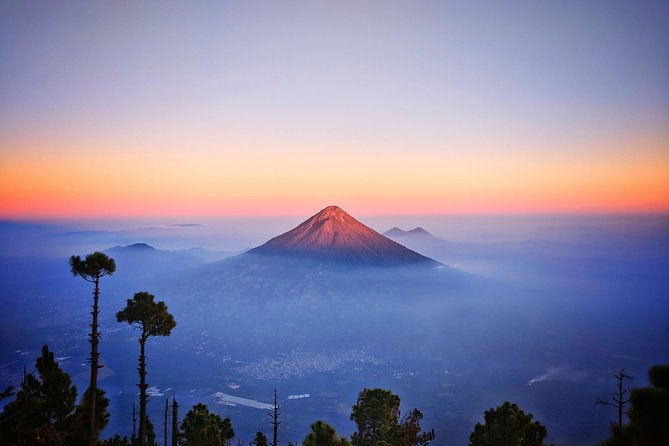 The Acatenango Volcano hike is a absolute must do in your Central America travel. It is a two day tour that departs at 9:00am and returns between 11:00am-11:30am depending on the pace of the group. Our minimum to make the tour run is 3 people. The trek is a 4-5 hour climb to basecamp  which over looks at the active Volcan de Fuego from 1km away where you might see an exceptional show of lava eruptions. From basecamp it would take an extra 1.5 hours to summit. It is a challenging and demanding hike, but it's doable with the right preparation. We aim to be able to summit if the weather allows it, by sunset. If this isn't possible we will try for sunrise; which is also possible to see from the basecamp in case you don't want to summit. <br><br>WE PROVIDE QUALITY GEAR, GUIDES AND BASECAMP. As well as safety gear for the active volcano tour. You don't carry any of the camping gear, only food water and personal belongings.