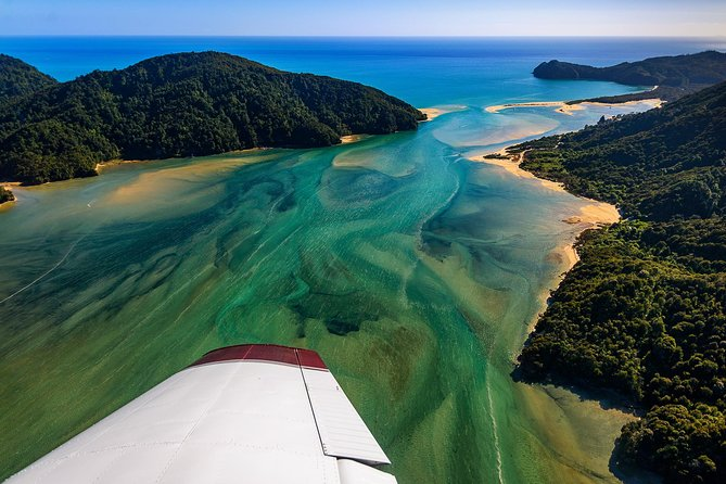 "Join Golden Bay Air for this amazing  ""Top-of-the-South"" day tour experience that takes you further off the beaten track to explore both stunning Golden Bay and gorgeous Abel Tasman National Park by air, land and by sea —with no retracing of steps. <br><br>This tour is packed with fantastic sightseeing and experiences. You'll have a spectacular scenic flight over Nelson and Abel Tasman golden beaches in a fixed wing aeroplane, take an easy walk to the clearest water in the world at Te Waikoropupu Springs, enjoy a scenic drive along the limestone coast of remote Golden Bay and enjoy time on the beaches in the famous Abel Tasman National Park. Finish with a spectacular cruise along the Abel Tasman, spotting dolphins and seals along the way with shuttle transfer back to Nelson. All including interesting commentary with friendly local tour guides."