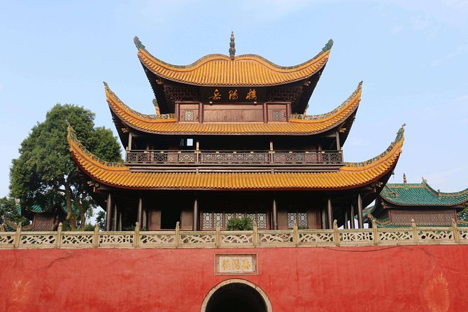 Yueyang is an old city in Hunan Province and located 160km from Changsha, This private day trip will let you explore the Yueyang Tower, Dongting Lake, Xiaoqiao Tomb, and Junshan Island etc. in Yueyang from Changsha by private car and a local guide.<br><br>At 8am, you will be picked up from the lobby of centrally located Changsha hotel, then drive 2.5 hours to Yueyang. You will visit the well-known Yueyang Tower firstly. Initially this three-storey tower was built in 220AD, and still preserves its original architectural style amazingly though it had been renovated in the history. There is an old tomb for a famous lady Xiaoqiao that is possible to visit near the tower. <br><br>After lunch, you will take 30-minute ride to Junshan Island, where you can wander around to visit the bamboos, old bridges, temple and gardens etc. <br><br>Later you will be transferred back to your hotel in Changsha, where the day tour concludes.