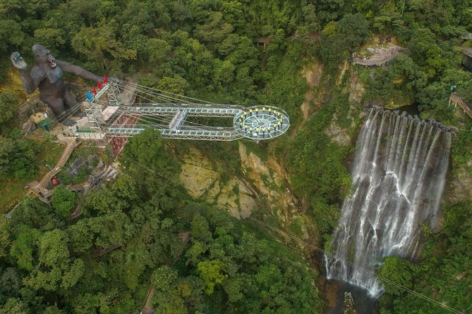 Gulong Canyon is located about 70 km from Guangzhou, which is well-known for its Glass Bridge recently. The total 1314-meter glass sky walkway is a wonderful place to view the canyon and waterfall. This day tour will start from Guangzhou and let you walk on the glass walkway to view the green canyon and waterfall.<br>At 8:30 am, your guide will pick you up from your centrally located Guangzhou hotel, then take 2-hour car ride to Gulong Canyon. You will walk on the imposing Glass Bridge(329m) and the Glass UFO Platform(202m), viewing the canyon and the waterfalls through the glass. Afterwards you will have a later lunch before you are transferred back to Guangzhou hotel where this day tour concludes.