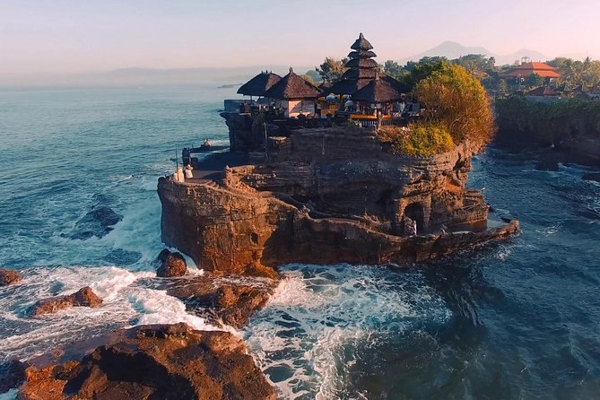 Bali Tanah Lot, Uluwatu, and Jimbaran Day Tour takes you to two most prominent sea temples in Bali within a single day. You will get the chance to admire the stunning views of Tanah Lot Temple and Uluwatu Temple. Both of these temples are famous for their magical sunset vistas. For lunch, your driver will take you to GWK Park, home to the biggest statue of Vishnu and his <br><br>vahana, Garuda. The tour will end in Jimbaran coastline where you will have a fancy dinner by the beach.
