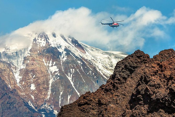 If you are in Kamchatka for few days, wish to extend your Itinerary or have 1-2 days left before you head back home, make your journey complete by taking a helicopter tour to one or few top Kamchatka attractions.<br><br>Just north of Petropavlovsk, there are Koryaksky, Avachinsky and Kozhelsky volcanoes. The Avachinsky Volcano (2151 m) is one of the most active on the Kamchatka peninsula. It has erupted at least 16 times since 1737. A large explosive eruption occurred at Avachinsky in 1945. The most recent eruption was in 1991 and produced lava flows, a dome, and mudflows. Because of its proximity to the Petropavlovsk, it is definitely a great complementary to the city's look and one of the favored places for hiking, skiing and trekking among local residents.