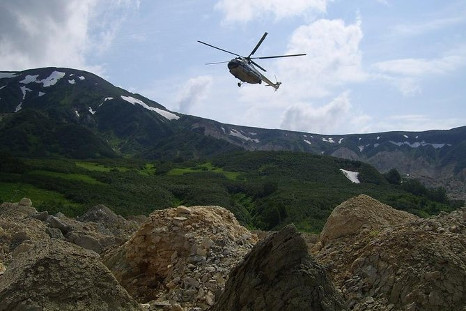 "If you are in Kamchatka for few days, wish to extend your Itinerary or have 1-2 days left before you head back home, make your journey complete by taking a helicopter tour to one or few top Kamchatka attractions.<br><br>During the tour, we will fly over remarkable Vilyucha, Gorely (1829 m) and Mutnovsky (2324 m) volcanoes. Located within ~ 70 km from Petropavlovsk, this group of volcanoes is particulary known for its ""breathing"" craters with geysers and gases colored in blue and yellow by fumaroles and mineralized thermal waters. If the weather permits, we will be able to fly into the Mutnovsky volcano crater and land for a short walk."