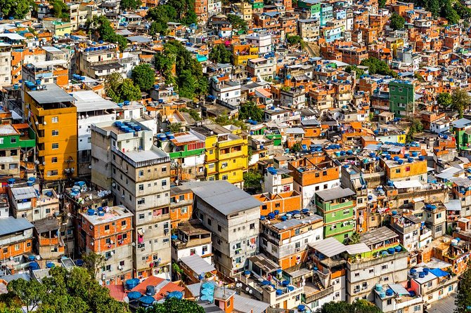 """Visiting the Rocinha favela, one of Rio's hundreds of """"favelas"""" (the Brazilian term for a slum or shantytown) and the largest in the country, is a local experience that gives you the chance to see Brazil from another point of view. With a resident guide, take a non-intrusive walking tour to learn about daily life in the favela and gain insight into the challenges these communities face.<br><br>Our pick-up starts at 13:30, however, our tour only starts in Rocinha around 14:10<br><br>Duration of our tour including pickup and drop off is around 3 hours. <br>"""