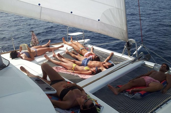 Sail on an unique catamaran along the best beaches in Ibiza anchoring for swimming, snorkeling and paddle boarding off the main coves such as Calabassa and Cala Conta. Sail next to Conejera island and across the bay of San Antonio at the west side of Ibiza, to enjoy a breathtaking sunset on board our luxurious catamaran right in front of Cafe del Mar and Cafe Mambo. This is a shared tour, but really private since we have a maximum of 12 people on board.