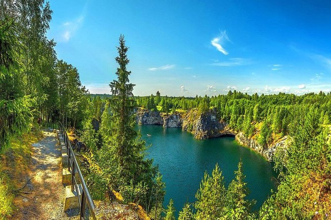 One of the most striking and surprising places of the Northern Ladoga area is the Ruskeala Mountain Park, a unique and multidimensional monument to nature and the history of mining. We offer you to enjoy the real Karelian nature in natural parks and reserves. You can see volcanoes, waterfalls, mountains, quarries, etc<br><br>We offer a tour to the Ruskeala marble quarries, which are located not far from Petrozavodsk. The heart of the park lies in the Marble Canyon. An old abandoned quarry, which delivered stone for almost three centuries, now caters for tourists. A huge bowl, carved by people in marble, stretches 456 meters from north to south, and is 109 meters wide. Filled with the purest emerald-green water, it is framed by slightly sloping and steep rocks, reaching a height of 25 meters above the water mirror.<br><br>A series of small cascade waterfalls on the river Tohmajoki is another sight you will visit during the tour.<br><br>• Guaranteed skip-the-line entrance