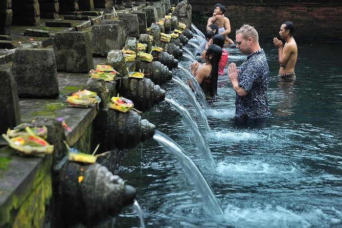 With this private tour you will enjoy a day trip in convenient way with our AC private car and friendly driver or guide. Get rid your bad spirit from your body by going in to a holy pool at Tirta empul templeas what Balinese believe. We will visit Holy water temple or Tirta Empul temple as the highlight for this trip. People may come just for sightseeing or joining the Bathing procession. We will visit other interesting places too such as: Scenic view of rice terrace in tegelalang village, visiting over than 700 Bali long tailed monkey in ubud monkey forest, Experience the process of making luwak coffee plantation and also will have a chance to try with many other variant of coffee, tea etc. As the last stop will be ubud market and palace to experience the atmosphere of market and visit the palace where the king of Ubud used to lived with his family.
