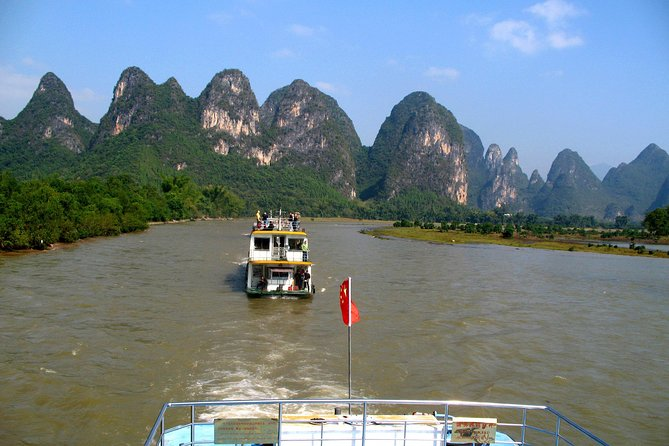 This small-group tour leads you to experience the classic and unforgettable cruise along Li River for 4 hours. It is one of the must-do highlights in Guilin. Embark on a deluxe cruise with your English-speaking local expert guide. This is the perfect chance to enjoy the picturesque view along Li River from Guilin to Yangshuo. A coach transfer back to Guilin can be arranged if you do not stay in yangshuo