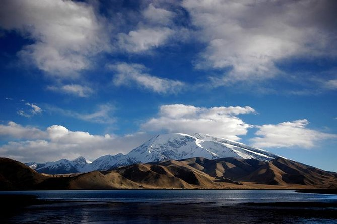 Karakul Lake, meaning Black Lake in Uyghur, is situated on the Pamir Plateau beside the Friendship Highway from Kashgar to Islamabad. This day trip will let you view the imposing the snow-covered mountains and the stunning high mountain lake.