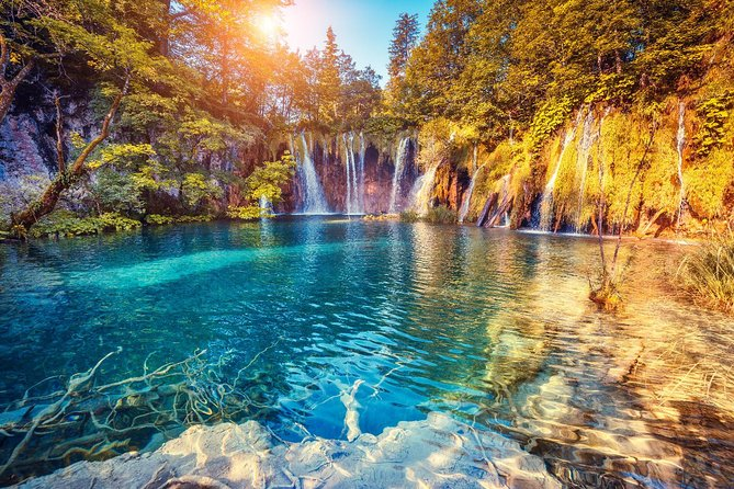 On this 12-hour tour from Split, you'll have the chance to explore the raw beauty of Croatia's famous Plitvice Lakes National Park. This UNESCO World Heritage site is not only the largest park in Croatia, but the oldest in the country, boasting 16 cascading lakes, breathtaking canyons, and even Croatia's tallest waterfall. Enjoy a short hike around the Upper lakes, hop on a short sightseeing cruise around the Lower Lakes, and finish with a scenic boat ride and optional lunch at a traditional restaurant. This small-group guided tour is destined to give you the experience of a lifetime. <br>