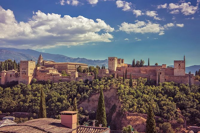 The Alhambra is the most visited monument in Spain. Our driver-guide will pick you up at your hotel / apartment in a private transfer. Upon arrival in Granada we will visit the Alhambra and all the places of the monument (Palacios Nazaries, Generalife Gardens, Palace of Carlos V and Alcazaba).<br>At the end of the visit, our driver-guide will transfer you to the city center, on a private tour of some of the most emblematic places such as the Albayzin neighborhood, the Mirador de San Nicolas.<br>After the visit, we return to Seville.<br>A very complete tour of approximately 10 hours where we will discover one of the most important monuments in the country. An immersive activity in the Muslim culture that was in Spain for more than 700 years.<br>It is important to carry your passport to access the monument.<br>Tickets are not refundable once the tour is confirmed.
