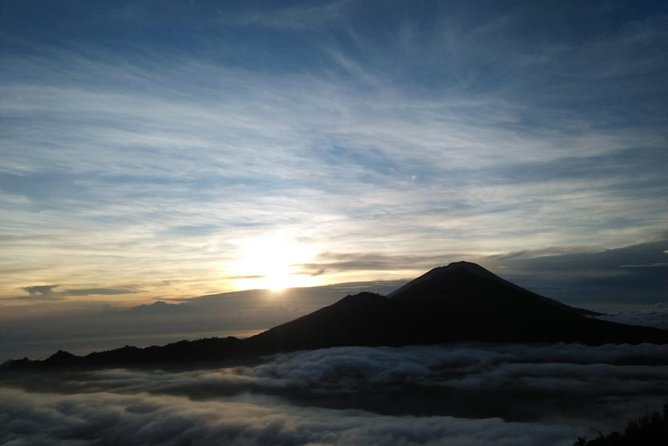 The magical island of Bali offers not just a relaxing tropical paradise, but also an opportunity for a unique trekking experience. Enjoy this full-day small group trekking tour of Mount Batur and then continue on to do some white water rafting.<br><br>With the help of experienced, local guides, you will have the chance to climb to the top of this active volcano in time to watch the sunrise, catching amazing views before having breakfast. You will then have a chance to get wet as you make your way down the river rapids.