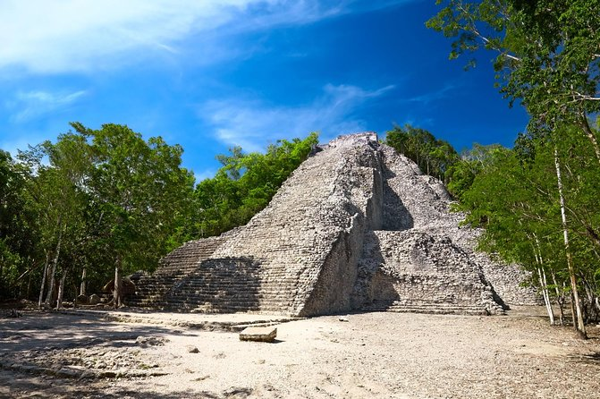 This 12-hour guided tour takes you to the two most significant archaeological sites on the Riviera Maya such as the seaside city of Tulum, where ancient ruins overlook the Pacific from a majestic cliff, and the inland capita of Coba, where you can climb the Yucatan's tallest pyramid and see the ancient roadway system used by the Maya to connect their cities. Enjoy lunch, swimming in a crystal-blue cave pool, and a final stop at Playa Paraiso, Tulum's white-sand beach, before returning to your hotel.