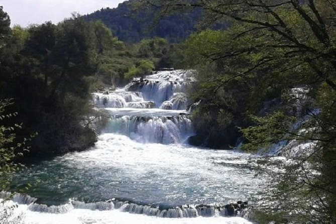 Krka National Park encompasses the area along the course of the Krka River, which flows through a deep and picturesque canyon for over 75 km and creates waterfalls- Bilusic buk, Miljacka, Brljan, Rosnjak, Manojlovacki slap, Roski slap and the fantastic Skradinski buk (Krka falls 46 m), Europe's largest travertine barrier.<br><br>Skradinski buk is the longest and most visited waterfall on the Krka River, and one of the best known natural beauties in Croatia. Here spills Krka over the 17 cascades which are formed by travertine barriers. Visiting this part of National Park you can view the cascades on a leisurely and safe walk along the walking trails and wooden bridges. Bathing is permitted at Skradinski buk so don't forget your bathing suit.<br><br>We can also visit the old water mills, the ethnography collection, the souvenir shop, or find refreshment in one of the hospitality facilities. On your request, we can visit river island Visovac or any other part of the National Park.