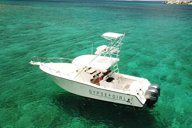 """Explore the Virgin Islands on your own Private Boat! """"Gypsea Girl""""is a 31 foot Grady-White Bimini equipped with twin 2016 300hp Yamahas. With a cruising speed of 30 knots, she is fuel efficient and quiet. She has extremely ergonomic seating, so there's always a great place to sit to enjoy the sunshine, the shade, or the beautiful views. """"Gypsea Girl"""" has a tower, which is awesome for jumping off and a great way to see everything the Virgin Islands has to offer. Our trips are completely customizable, so you choose what you want to do. If you're unsure about where to go or what to see, our captains know the area well and will take you out on the best trip of your vacation! All excursions include your Private Boat, Captain, Snorkel Gear, Bluetooth music hook up, Canned beverages (soda, beer, water and ice),lots of extras and good vibes."""