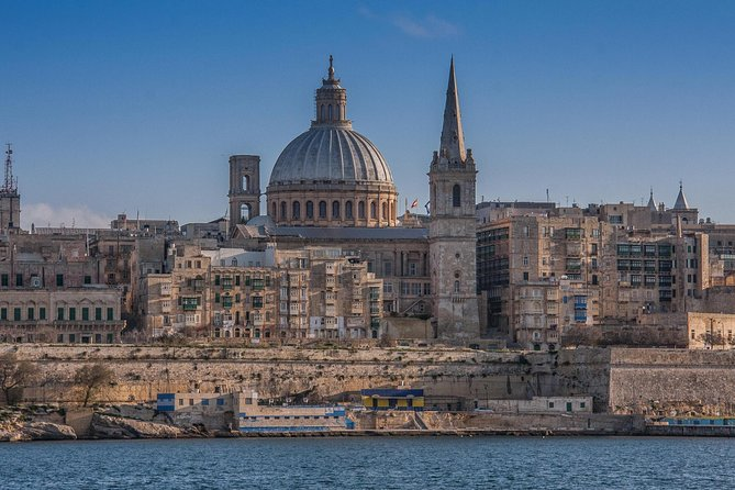 The island's size works in your favour in this postcard-perfect full day tour of Malta. <br><br>You'll walk along the same narrow streets as the Knights of St John, take in the sights and smells of Malta's most famous fishing village 'Marsaxlokk' and gaze in awe as you step into the island's most ancient temples, dating back over 5,000 years. Enjoythe stunning views from Dingli Cliffs,tuck into afeast for your taste-buds with local 'pastizzi', before quietly wandering through the silent city of Mdina, with its jaw-dropping views of Malta. You'll end your day the way the locals do, with delicate sand playing between your toes and the stresses of the day ebbing away.<br><br>We cover the best of Malta in this full day tour, however if you'd like a more customised or specific themed experience of the country, just let us know. We're happy to help.