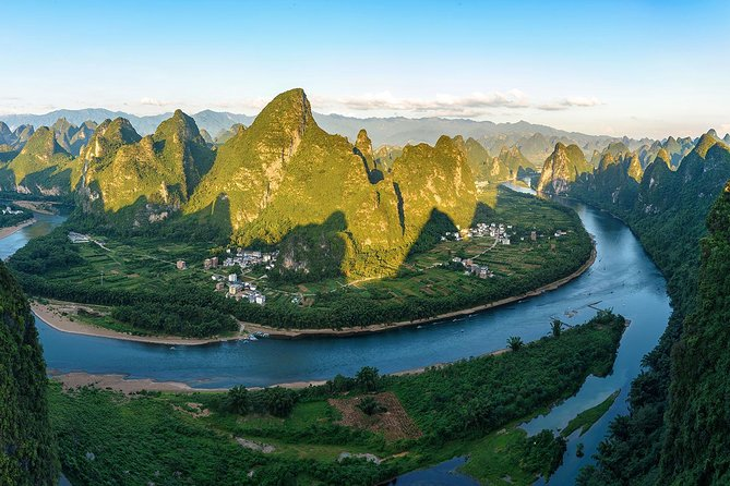 In this day you'll have a bird-view of the amazing landscape of the hills and rivers on the top of a mountain, you'll have a closer touch to the beautiful and clear Li River on a drifted boat just enjoy the beauty of the nature, what's more you'll have a bicycle ride into a beautiful local village of Yangshuo where rivers are flowing, birds are singing and flowers are blooming. Just forget the hustle and bustle of the city, just take off all the burdens of lives, just pretending you are staying in paradise! What a wonderful day!