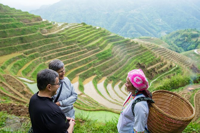During this 1-day tour, your local professional guide from Guilin will accompany you as you hike to the Longji Rice Terraced Fields and visit two minority villages. You'll admire the most beautiful scenery of the terraced fields from different angles and discover the local minority cultures of the Zhuang and Yao peoples.
