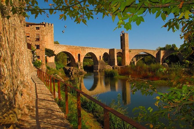 If you are nature lovers and you like to discover new areas, this is the best option for you!!<br><br>On this full day tour you will explore different areas, the first area with a lot of history where our guide will explain the medieval and Jewish heritage of Besalú and a second part of the day to enjoy the nature of the Natural Park of La Garrotxa, in the pre-Pyrenees area with more than 40 volcanoes none of them active for thousands of years. You will prove it with your own eyes visiting a Medieval hermitage located in the middle of the crater of one of them. Also you will visit Castellfollit de la Roca to take some photos of the Basaltic cliff and Santa Pau an small village sorrounded by volcanoes.<br><br>To finish this amazing day, you will have the opportunity to have a walk or to sail at the Banyoles lake , the largest lake in Catalonia.<br><br>We will come back to Girona city about 5/5.30pm depending on the traffic.