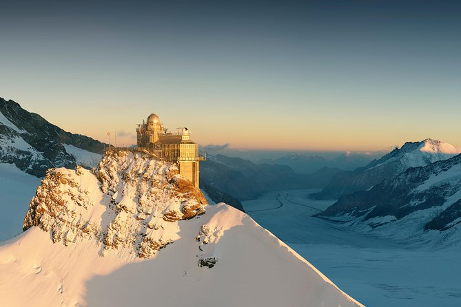 """Spend a day at Jungfraujoch - Top of Europe with your private tourguide. Travel from Bern on an intercity train to Interlaken. From there via Lauterbrunnen and Wengen to Kleine Scheidegg, where the Jungfrau railway starts. Enjoy the view at the scenic stop Eismeer. Shortly after that, you arrive at Jungfraujoch, 11,333ft above sea level. With your tourguide you discover the multimedia show, the Sphinx terrace, the exhibition """"Alpine sensation"""", the ice cave and the chocolate world of """"Lindt"""". Enjoy a beautiful panorama in the glacier world."""