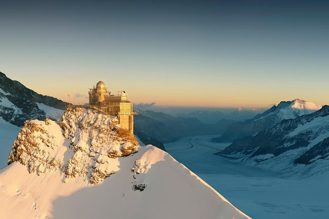 A must for a visit in Switzerland is Jungfraujoch – Top of Europe in the Bernese Alps, connecting the two four-thousander peaks Jungfrau and Mönch, at an elevation of 3,466 metres (11,371 ft) above sea level. It's part of the Jungfrau-Aletsch area, belonging to the Unesco world heritage site. <br>A aerial cableway and a coghwheel train connects the Jungfraujoch with Grindelwald and Lauterbrunnen. Since 1912, this fantastic glacier world is accessible by coghwheel train. <br><br>The tour begins with the travel from Interlaken to Grindelwald, where the Jungfrau railway line starts. It is a varied tour with a constantly changing landscape up to Jungfraujoch - Top of Europe with the highest train station in Europe. <br><br>At the Top of Europe, your guide will take you on a tour through the attractions like the Sphinx terrace, the viewing platform, the Alpine sensation exhibition and the Ice cave. The building include several panoramic restaurants and shops.