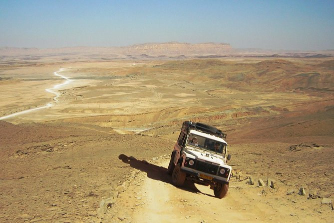 Enjoy a 2-hour 4x4 jeep tour to Ramon Crater from Mitzpe Ramon. A Machtesh or a crater is a unique geological phenomenon, exists only in the Negev desert, Israel. A jeep tour in the crater is absolutely the best way to experience the essence of desert adventure. Along the tour you will pass through countless earth colors, Beautiful landscapes and interesting points. Along the tour we will tackle some hard and rugged trails, climb up mountains to see the magnificent desert landscape, cross dry river beds, taste and smell some of the unique desert vegetation, observe local wildlife and touch and feel the rare minerals of earth. The tour is accompanied by a professional tour guide, certified by the Israeli ministry of tourism.