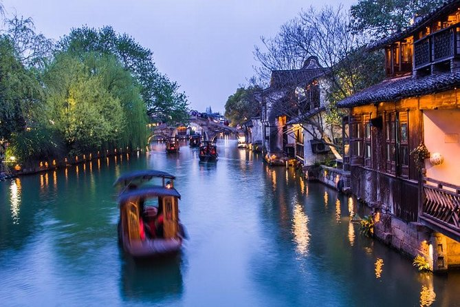 Discover Shanghai's most incredible city attractions and beautiful Zhujiajiao Water Town during this wonderful private day tour. Accompanied by a professional guide, stroll around the old lanes with antiquated architecture, wander along the canal with old bridges and take the boat on tranquil canals in Zhujiajiao for a half day. Followed by another half day tour to see the Shanghai city top attractions, such as Yu Garden, the spectacular skyline on the Bund as well as the panoramic view from the top of Shanghai Tower. An authentic Chinese lunch in the water town, boat ride ticket, entrance fee to Shanghai Tower, private guide and driver service are all inclusive.
