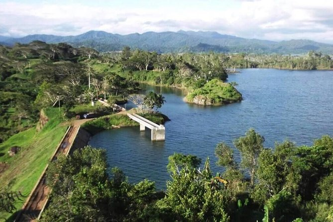 This full-day private tour of the Sogeri Plateau near Port Moresby is suitable for visitors who have already toured the main city and would like to see more of the surrounding countryside. While the coastline north and south of Port Moresby is dry bushy terrain interspersed with swamp, the inland road climbs to the Sogeri Plateau, a green oasis of fertile farmland and forested mountains. After an initial stop at the Bomana War Cemetery, you'll visit the Adventure Park Zoo, National Orchid Gardens and bird of paradise breeding facility before a steep climb through the Rouna Gorge to the scenic Sogeri Plateau, with optional side trips to Owers Corner (the beginning of the Kokoda Trail), the Varirata National Park with its panoramic views of the Papuan Coastline, the Crystal Rapids cascades on the Upper Laloki River and the Sirinumu Reservoir, a man-mad lake which supplies water for Port Moresby's reticulated supply and hydro-electricity generation.