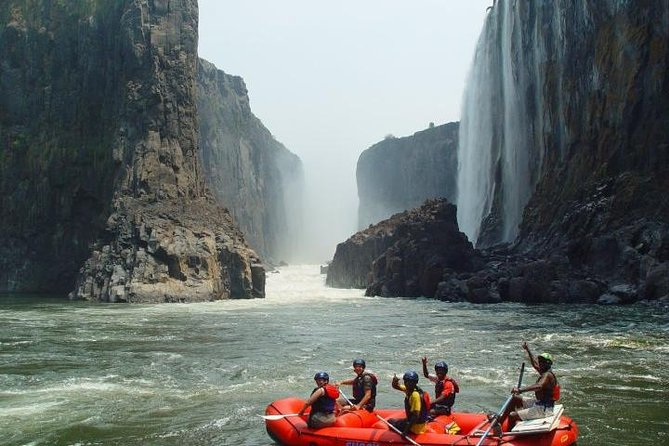 If you're looking for adventure in Zimbabwe, experience the Zambezi River on a white-water rafting tour with pickup in Victoria Falls. With a guide, travel down one of the best one-day rafting rivers in the world, which plummets into a gorge at Victoria Falls, separating the placid river above the falls and the turbulent rapids below. The gorge is more than 328 feet (100 meter) deep at the falls and increases to more than 650 feet (200 meters) by the end of the full-day raft trip. Select a half-day or full-day trip when booking (dependent on availability). Water levels will determine whether you do low- or high-water rafting.