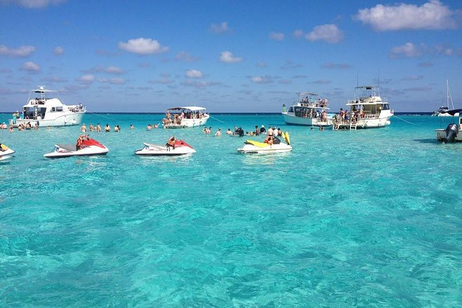 This tour will be customized and private just for you! YOU tell us any THREE stops you would like to make! <br><br>Stingray City Sandbar – Interact with the friendly stingrays and enjoy swimming, holding, touching the  Stingrays and taking photos. <br><br>Starfish Beach – This small private and quiet beach is known for and named after the Caribbean Sea stars (Starfish) that can always be found there. <br><br>Snorkeling at the barrier reef or Coral Gardens – With 120+ foot visibility  you can see everything in the water!  You can see a wide variety of corals, marine life  including lobster, conch, a variety of colorful fish.  Occasionally you can see turtles, a green eel or even our wild dolphin, Stinky. <br><br>Rum Point Beach – You can enjoy beach volleyball, swimming or wading on the beach, beach bar and restaurant or just lay back and soak up some sun at this stop.