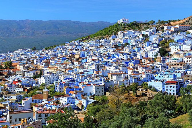 in Fes to chefchaouen day tripAfter breakfast in your Riad or Hotelwe will start your day trip toward Chefchaouen (the blue city) which is a Morocco popular tourist attraction and welcoming town situated in the Rif Mountains just south of the Mediterranean coastline in northwest Morocco. This nice bleu city is known for its traditional buildings. Enjoy a walk to explore the white and blue washed walls of the medina and the markets that offer some unique native handicrafts. Chefchaouen is a fantastic destination for photography with its wonderful views of the Rif Mountains. Back to Fez in the afternoon