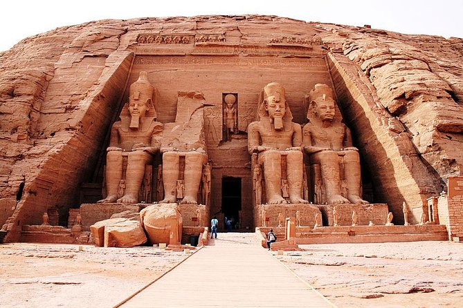 "The Astonishing ""Abu Simbel"" Temples on a private tour from Aswan that reveal the ancient sanctuaries carved straight into a sandstone mountain. Travel to the edge of Lake Nasser in the comfort of a private, climate-controlled vehicle, enjoying expansive views of the Nubian desert along the way. Upon arrival, explore temples dedicated to Ramses II and his wife Nefertari, with extraordinary artwork that brings the ancient world to life. <br><br>A day of adventure is waiting for you on this tailor-made tour with an Egyptologist guide. An early start is well worth it as you see the UNESCO World Heritage Site of Abu Simbel. Explore the mighty twin temples of Ramses II, considered among the most inspiring temples in ancient Egypt"