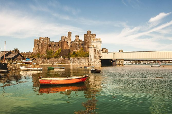 King Edward built a castle in Conwy, King Arthur slayed a giant in Snowdonia, and the Romans laid the foundations for the town of Chester: this part of the world is packed full of myths and marvels.<br><br>And on this tour, your guide takes you on a journey through the best of the must-see sights.<br><br>You explore Conwy where a castle watches over a bustling harbour town. You visit Betws-Y-Coed, a quaint village nestling amongst the stunning mountains of Snowdonia. And you explore Chester, a town that's blessed with one of the most brilliant cathedrals in all of England.<br><br>It's a day tour that's perfect for anyone who enjoys a mixture of castles, beautiful landscapes, and curious towns.
