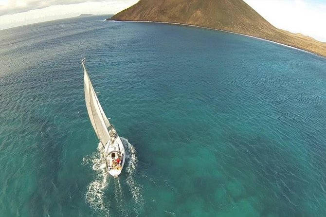Enjoy a 4-hour private sailboat tour from Corralejo to Lobos Island. Explore the turquoise sea as you stop for water sports such as snorkeling, paddleboarding, and fishing, or just relax and sunbathe. Sip on a cold drink and listen to the calming sounds of the ocean and the billowing sails as the crew caters to your every need. Lunch is included. Morning, afternoon, and evening departure times are available so you can choose what time of day you'd like to be out on the water.
